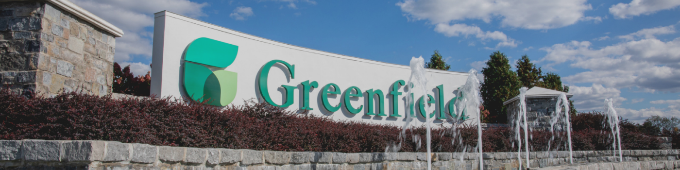 Greenfield entrance sign and water fountain